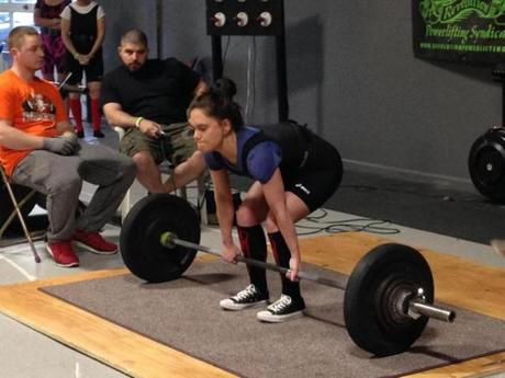 "PHOTO 8 – Laura doing a deadlift in competition. CUTLINE: ""Though just 5-foot-2, Laura was an avid weightlifter, competing here in her first women's ""powerlifting"" competition in 2015. Her husband is establishing a foundation in her name, Lift4Laura.org, that will fund personal gym training sessions for underprivileged and abused women."" PHOTO BY PETER DEMARCO"